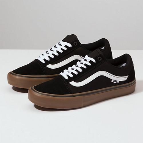 zapatillas vans negras y marrones
